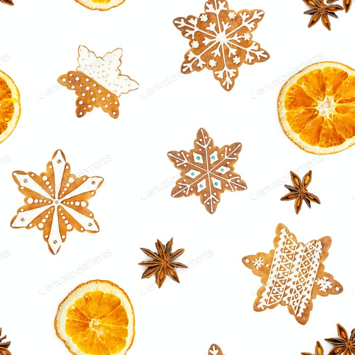 Seamless pattern with Christmas gingerbread cookies in the shape of snowflakes and dried oranges