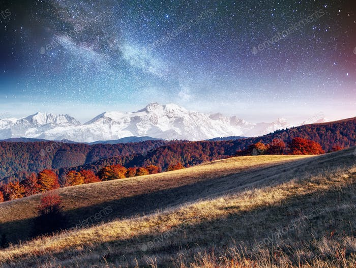 Fantastic starry sky and the milky way. The picturesque snow-cap
