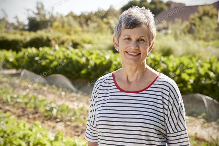 Portrait Of Mature Woman Standing On Allotment