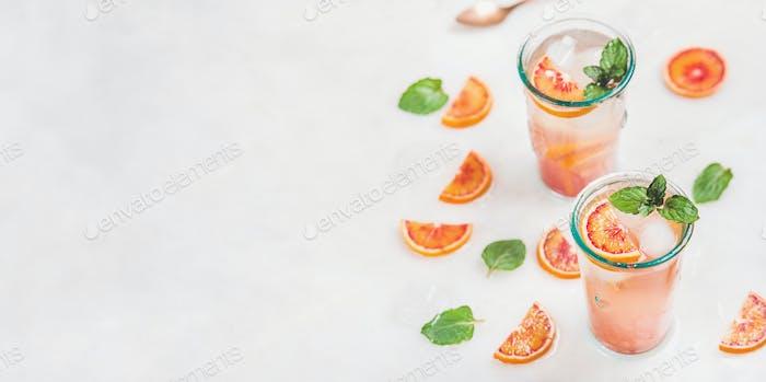 Homemade blood orange lemonade with mint and ice
