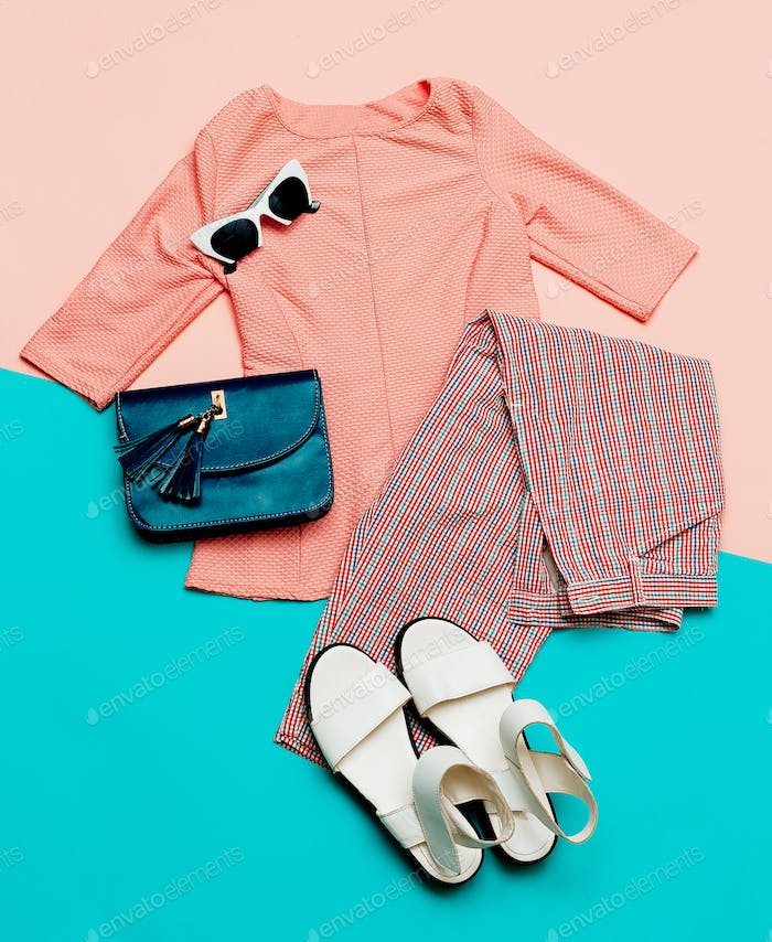 Stylish summer clothes. Vintage. Checkered trousers. Outfit
