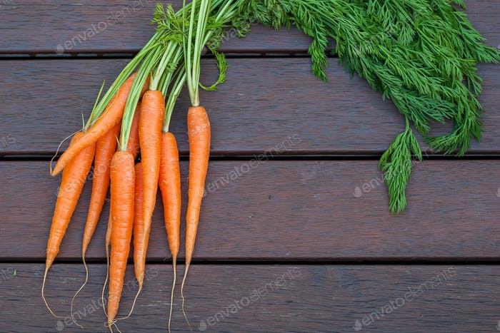 Bundle of carrots on the wood