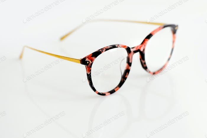 Female fashion glasses on white background