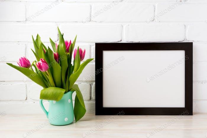 Black brown  landscape frame mockup with magenta tulips in mint