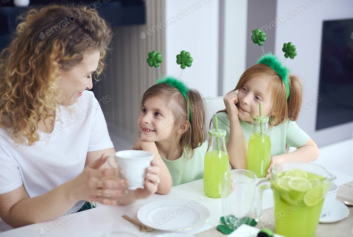 Mother talking by their children at table