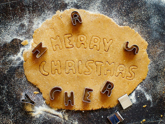 Making cookie words Merry Christmas