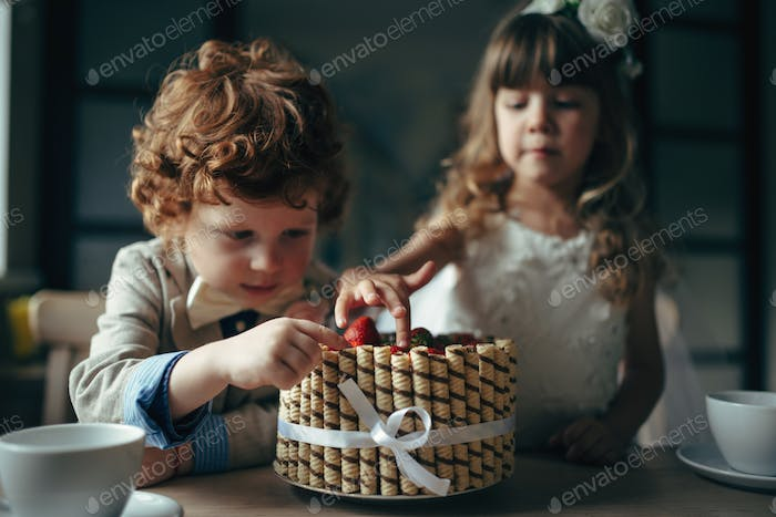 boy and girl having tea party in cafe