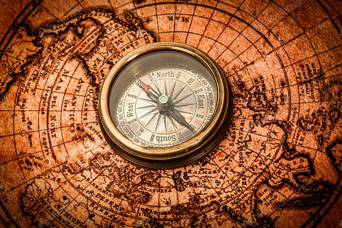 Vintage compass lies on an ancient world map photo by cookelma on vintage compass lies on an ancient world map gumiabroncs Gallery