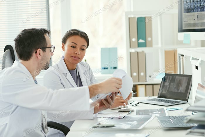 Doctors examining the medical card together