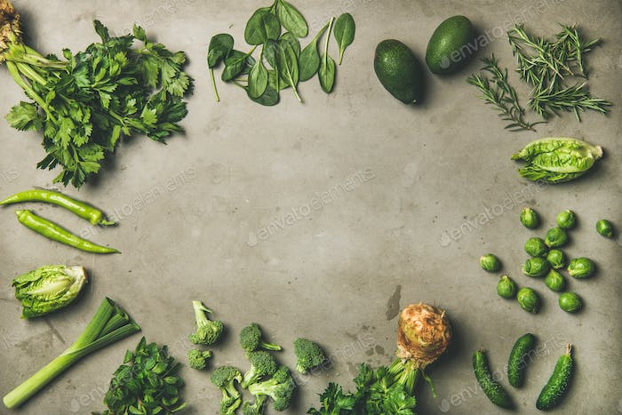 Healthy vegan ingredients layout over concrete table background, copy space