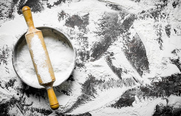 Flour with rolling pin and sieve.