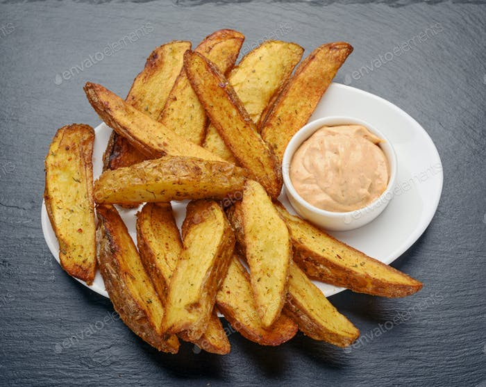 fried potatoes with Mexican sauce
