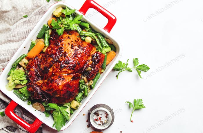 Baked chicken in honey glaze with garnish of vegetables