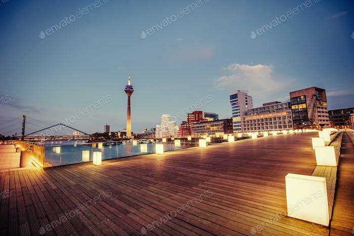 Night city landscape Dyusildorf. Media harbor. Germany. Soft lig