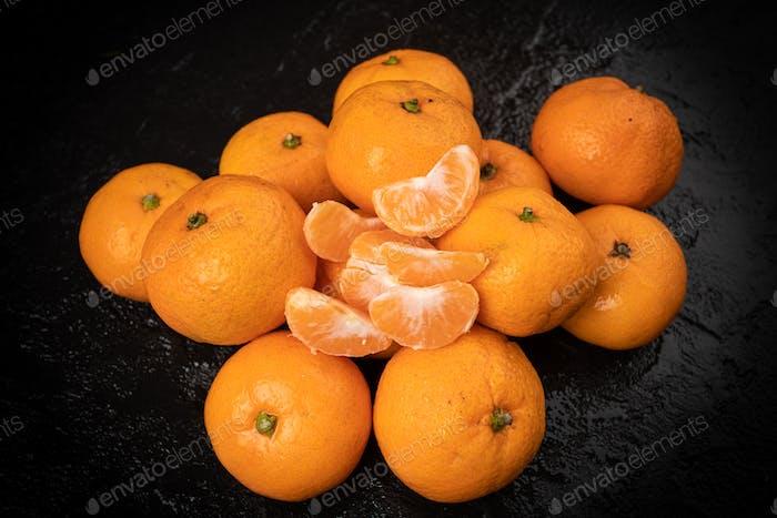 Mandarines, tangerine, clementine on black background