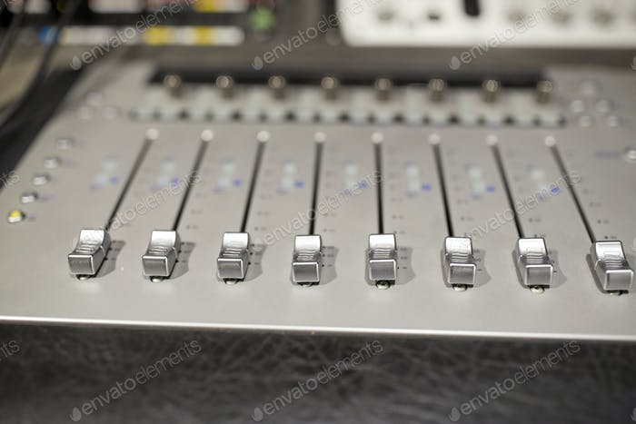music mixing console at sound recording studio