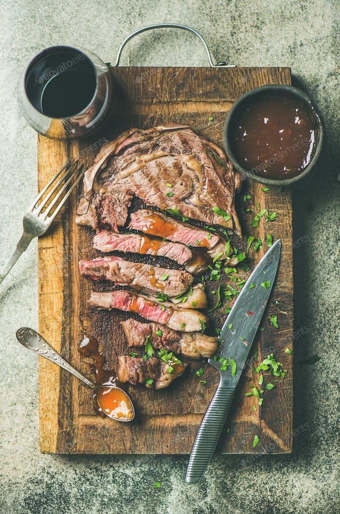 Flat-lay of grilled medium rare ribeye beef steak