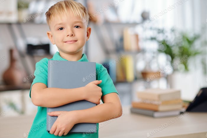 Preteen kid with notebook
