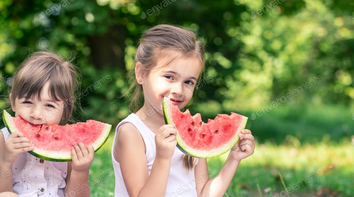 girl with a watermelon smiling