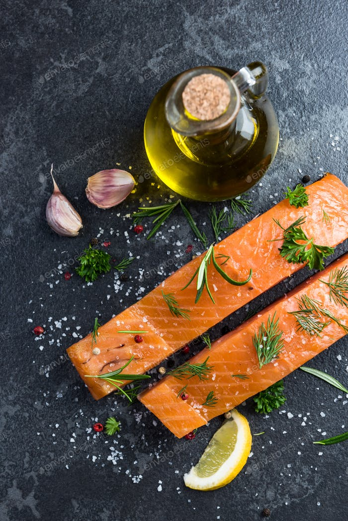 Preparing salmon fillets with herbs and spices