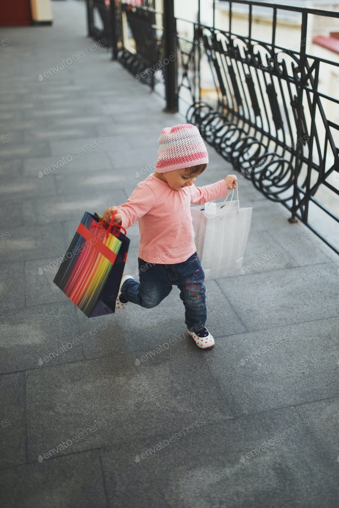 cute little girl with shopping bags