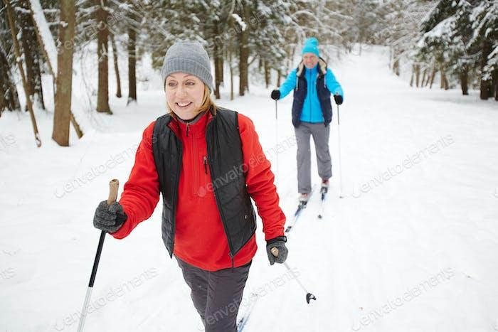 Spouses skiing