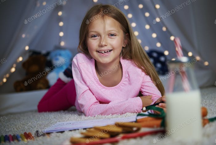 Cheerful girl posing while drawing