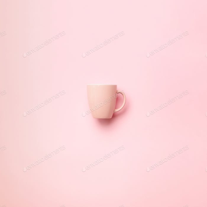 Pink cup over punchy background. Square crop. Birthday party celebration, baby shower concept