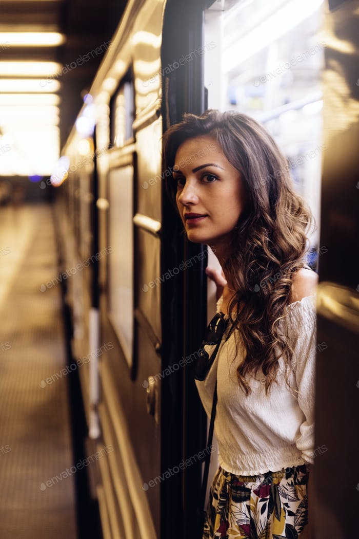 Beautiful woman passenger in the subway of Budapest.
