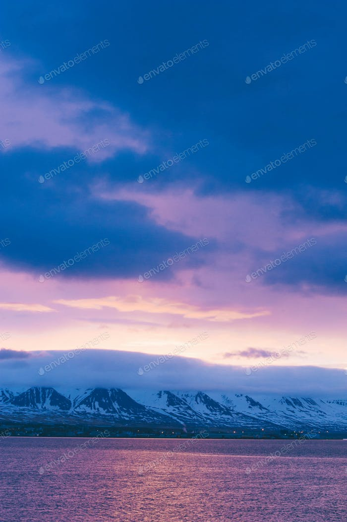 Iceland nature landscape road  with clouds and amply field village and lake river