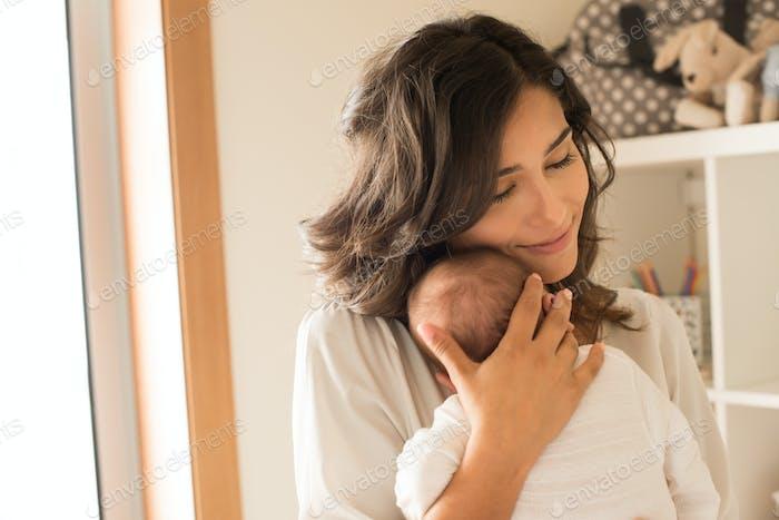 Woman with newborn baby
