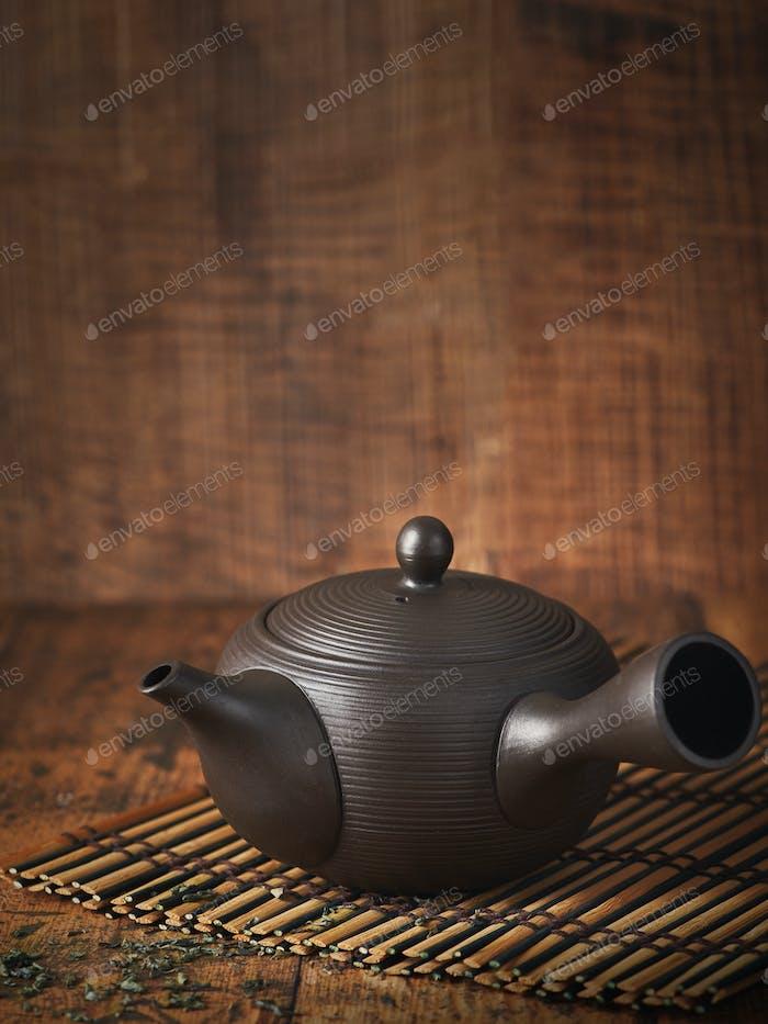 Traditional japanese ceramic brown teapot. Wabi sabi concept.