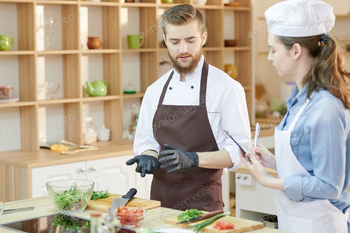 Two Young Chefs in Restaurant Kitchen