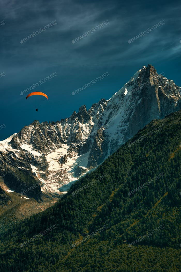 Orange paragliding in the mountains