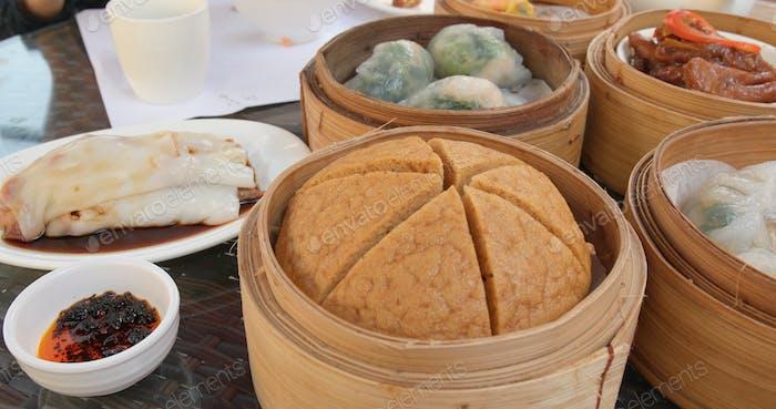 Eating Chinese dim sum in restaurant