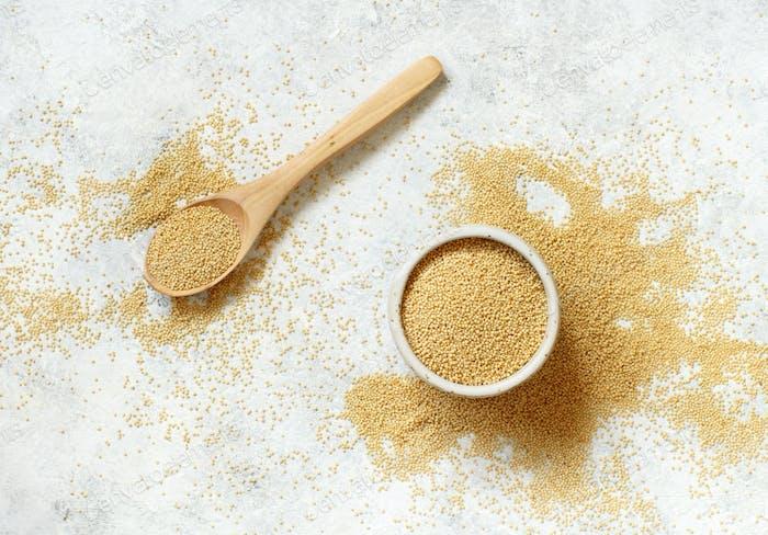 Raw Amaranth Grain on a white table