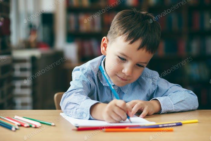 Preschool boy drawing