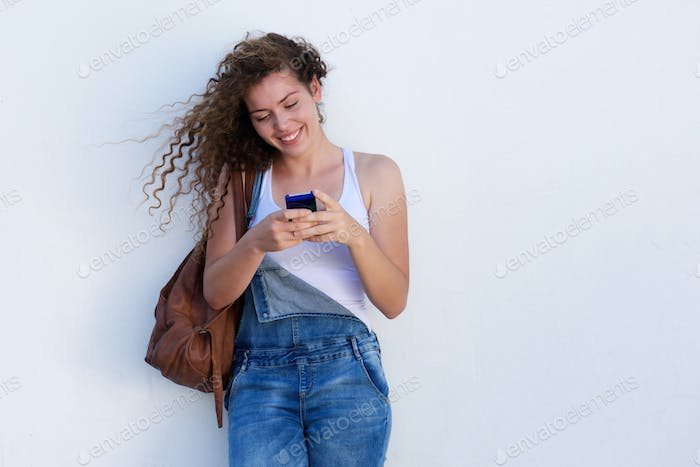 Thumbnail for Happy young girl on cellphone texting