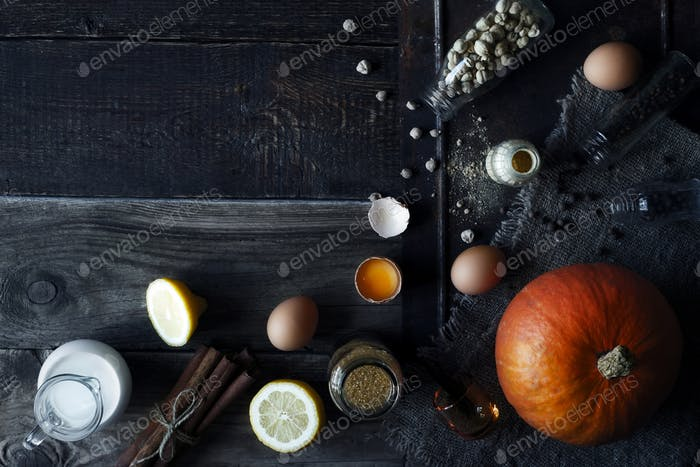 Ingredients for pumpkin pie on the wooden table top view