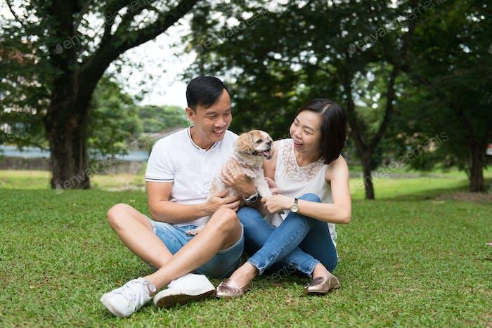 Asian lovely couple with shih tzu dog