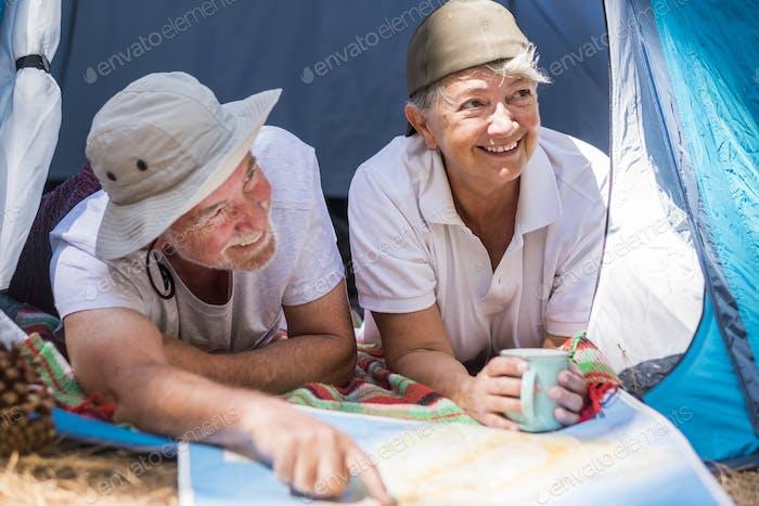 couple of adult senior caucasian traveler inside a tent