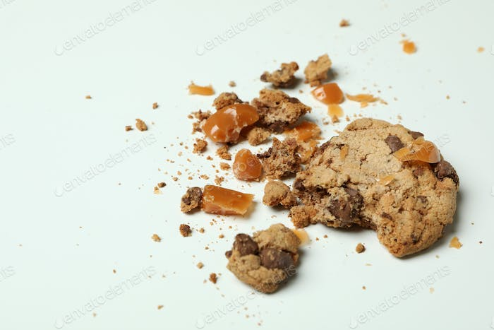 Tasty cookie with caramel on white background