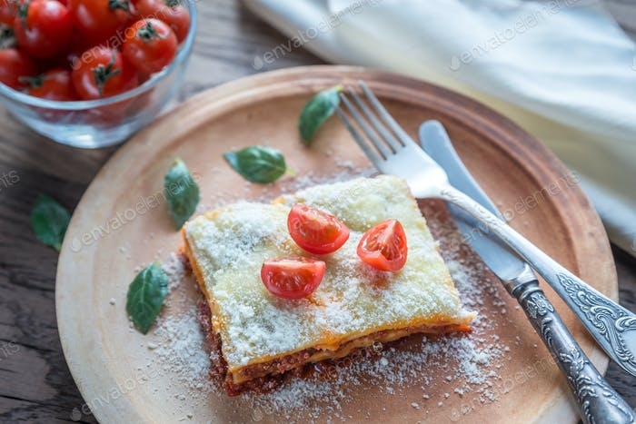 Lasagna with cherry tomatoes and fresh basil: top view