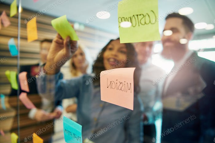Cheerful entrepreneurs planning a project in office