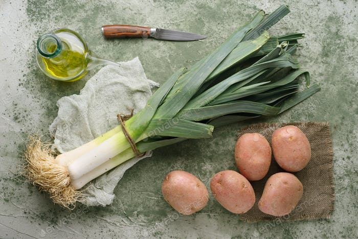 leeks and raw potatoes, on a marbled green background