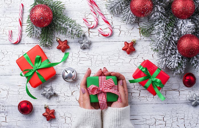 Christmas gift box in hands