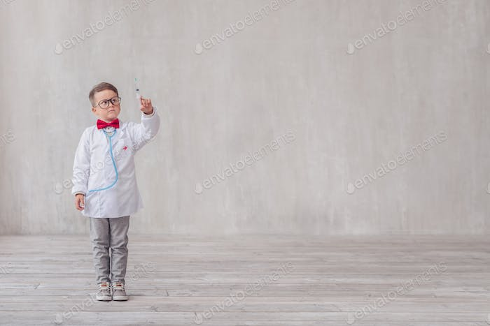 Little boy with a syringe