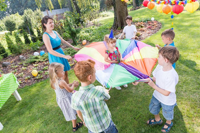 Kids playing parachute games