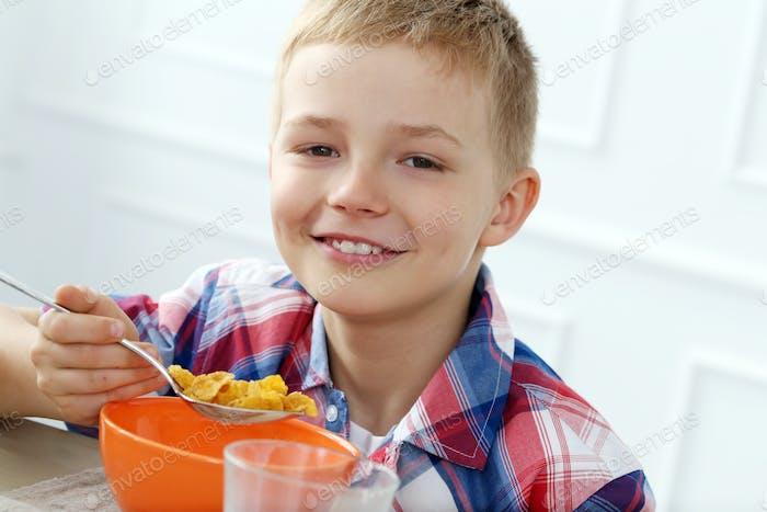 Breakfast. Boy by the table