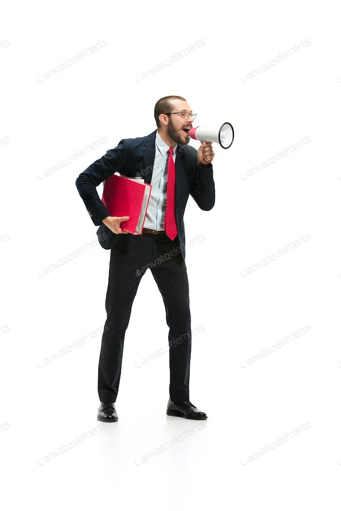 Side view of a man screaming on the megaphone over white background